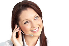 Charming young businesswoman wearing earpiece Stock Photo