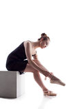 Charming young dancer puts on pointes Stock Images