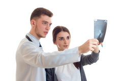Charming young doctor stretched forth a hand and shows the girl x-ray close-up Stock Images