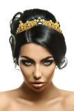 Charming young fashion model with crown on head and creative bla Royalty Free Stock Photo