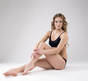 Charming young female athlete posing in studio Stock Images
