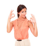 Charming young female gesturing a great job Stock Image