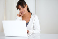 Charming young female reading the laptop screen Stock Photo