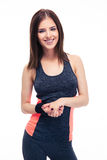 Charming young fitness woman looking at camera Stock Photo