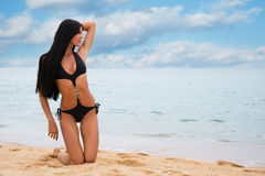 Charming young girl on the beach Stock Photography