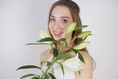 A charming young girl with big eyes and brown hair stands without makeup in a fashion dress on a white background in the Studio. b. Eautiful young teen woman royalty free stock photos