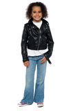 Charming young girl in bikers leather jacket Stock Images