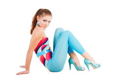 Charming young girl in blue on floor Stock Photos