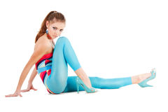 Charming young girl in blue on floor Stock Image
