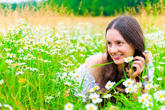 Charming young girl in field with lush grass Royalty Free Stock Photo