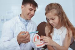 Beautiful young girl visiting dentist royalty free stock photos