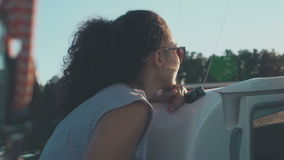 Charming young girl looks afar floating the sailboat stock video footage