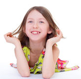 Charming young girl lying on the floor Stock Photos
