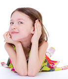 Charming young girl lying on the floor Royalty Free Stock Photo