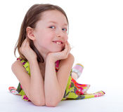 Charming young girl lying on the floor Stock Photography