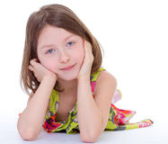 Charming young girl lying Royalty Free Stock Image