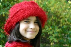 Charming young girl with red hat royalty free stock images