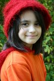 Charming young girl with red hat royalty free stock photography