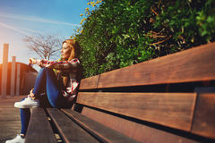 Charming young girl relaxing in the spring park Stock Photography