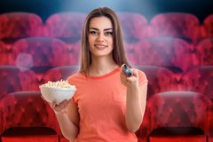Charming young girl watching fun movie royalty free stock images