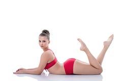 Charming young gymnast posing looking at camera Royalty Free Stock Photos