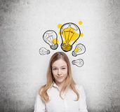 Charming young lady creates new business ideas. Royalty Free Stock Photography