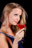 A charming young lady holding a glass of red wine Stock Photos