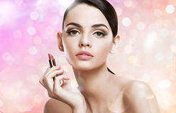 Charming young lady with lipstick Stock Photography