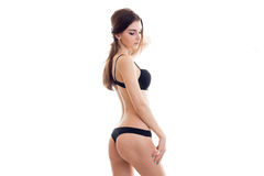 Charming young lady with sexy round ass in black lingerie Stock Images