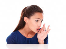 Charming young lady whispering a secret Stock Images