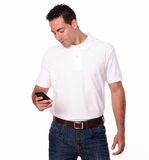 Charming young male using his cellphone Stock Photography