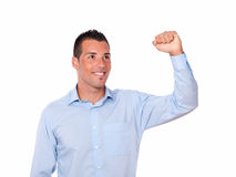 Charming young man celebrating his victory Stock Image