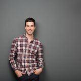 Charming young man in checkered shirt smiling Royalty Free Stock Photography