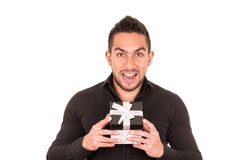 Charming young man holding a gift box Royalty Free Stock Photography