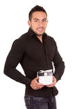 Charming young man holding a gift box. Isolated on white Royalty Free Stock Image