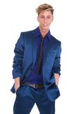 Charming young man posing in blue suit Royalty Free Stock Image