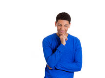 Charming young man smiling happily thinking about something, holding his chin Royalty Free Stock Photography