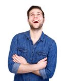 Charming young man smiling and looking up Royalty Free Stock Images