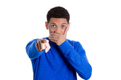 Charming young man stunned and dumbstruck pointing at the camera Royalty Free Stock Images