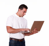 Charming young man working on his laptop Stock Photography