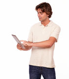 Charming young man working on tablet pc Royalty Free Stock Image