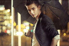 Charming young model with umbrella Royalty Free Stock Photography