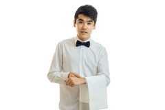 Charming young waiter stands upright with cloth on hand. Isolated on white background Royalty Free Stock Photos
