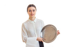 Charming young waitress with trey in hands in uniform Royalty Free Stock Photo