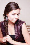 Charming young woman. Sitting  on a sofa Royalty Free Stock Photos