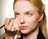 Charming young woman applying blusher eyelid Royalty Free Stock Photography