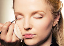 Charming young woman applying blusher eyelid Royalty Free Stock Photos