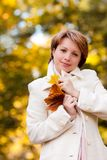 Charming young woman in an autumn park Royalty Free Stock Image