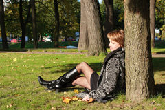 Charming young woman in an autumn park Royalty Free Stock Photo