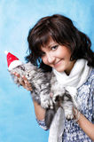 Charming young woman with cat. Isolated on blue background stock image
